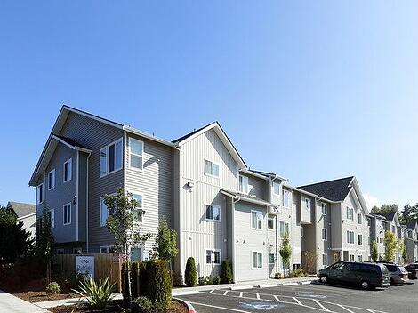 7 Common Problems Landlords Face — Large Gray Apartment Complex