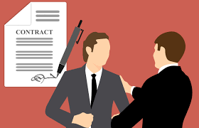 How to Switch Property Management Companies in Seattle - Two men in suits shaking hands after signing contract