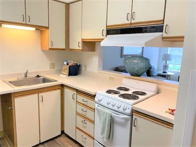 Interior of full kitchen in Parkview 55+ apartment at Daystar Retirement in West Seattle