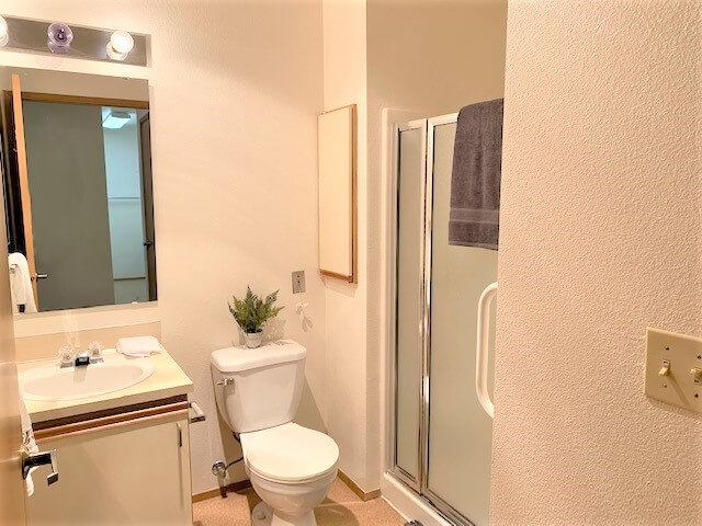 Quaint bathroom with shower Parkview 55+ apartment at Daystar Retirement in West Seattle