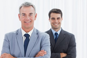 Smiling property managers posing in bright office looking at camera